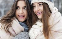 Close up of female Russian friends posing for a photo during the winter